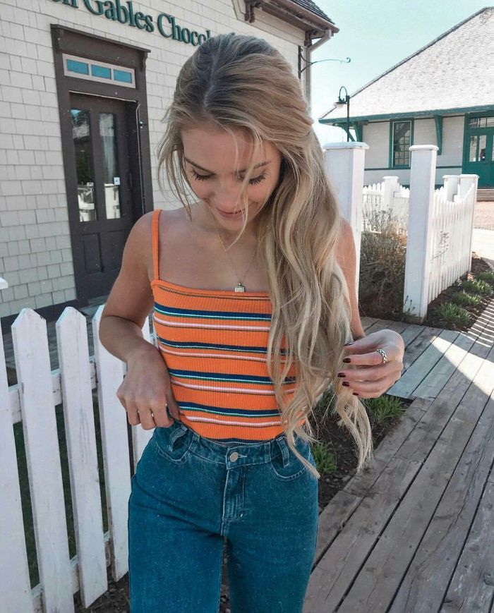 cute clothes for teenage girl jeans orange and blue striped top worn by blonde girl