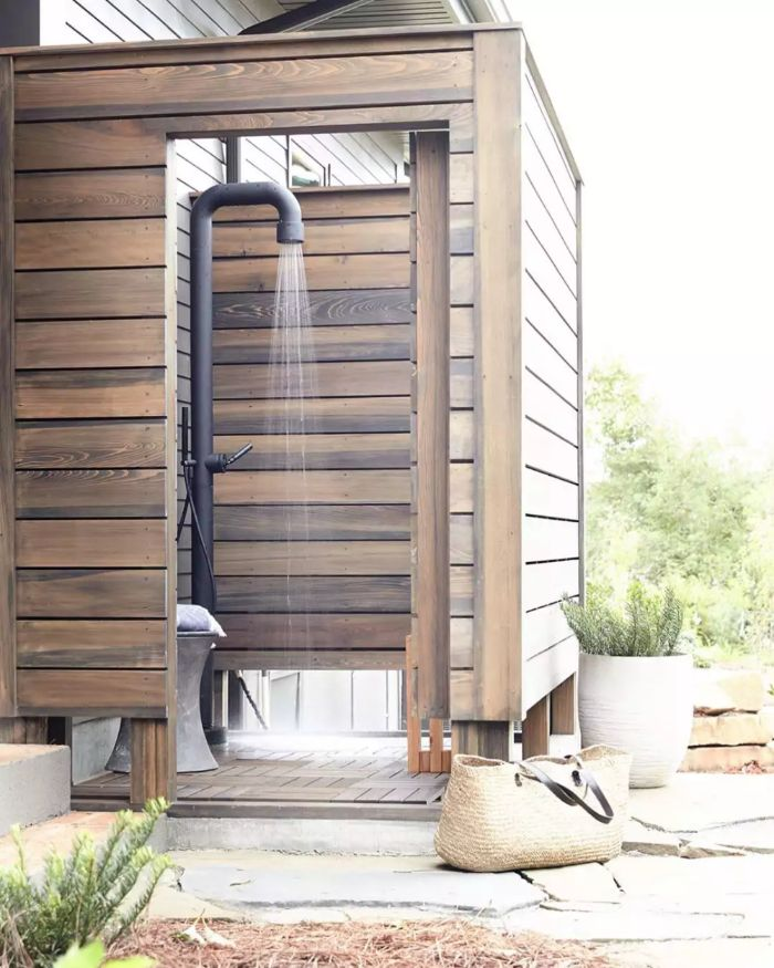 diy outdoor shower wood enclosure in industrial style with metal black pipe for shower