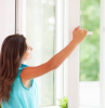 door installation woman with long brown hair wearing blue top opening window