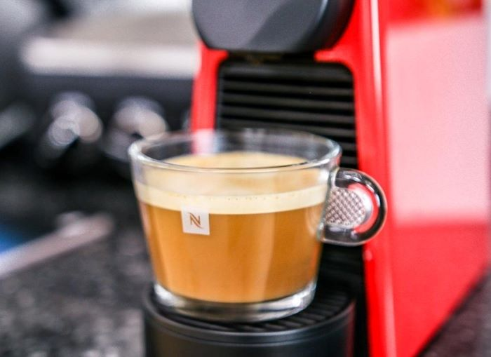 glass coffee cup placed on espresso machine coffee to water ratio filled with coffee