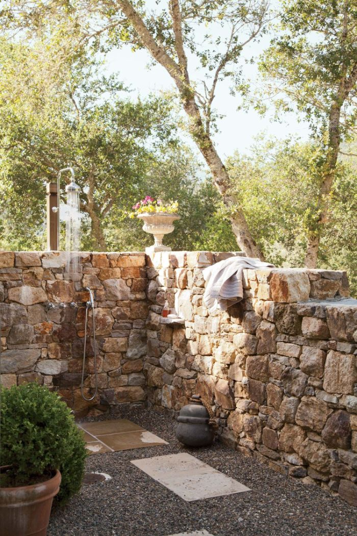 gravel and tiles on the floor diy outdoor shower enclosure stone wall with shower mounted on it