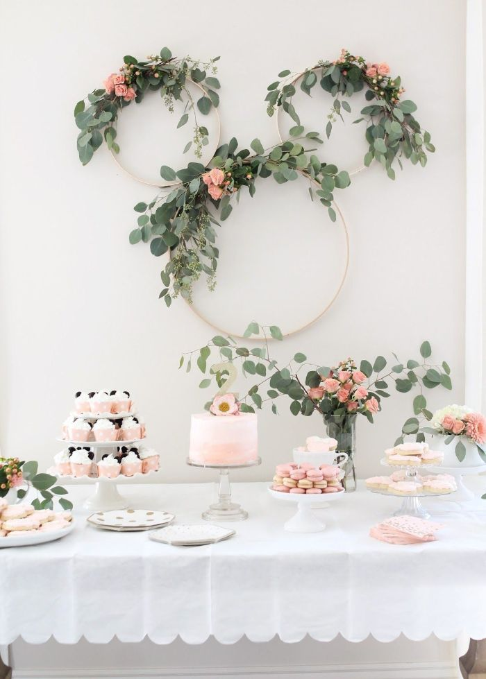greenery wreaths over dessert table with cake cupcakes macaroons boy baby shower decorations minimalistic decor
