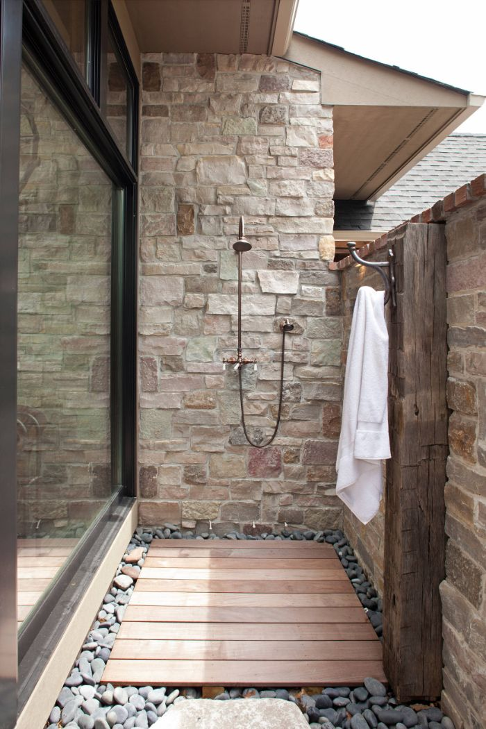 hook for towel outdoor shower designs shower mounted on stone wall wood floor with rocks around it