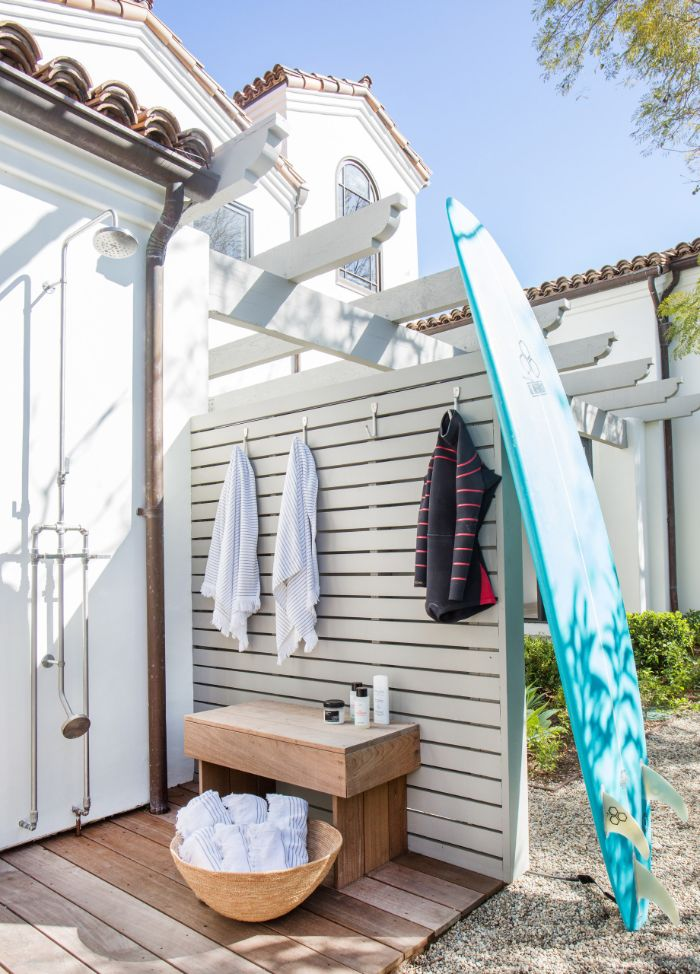hooks for towels wet suit freestanding outdoor shower surf leaning on the wall wood floor