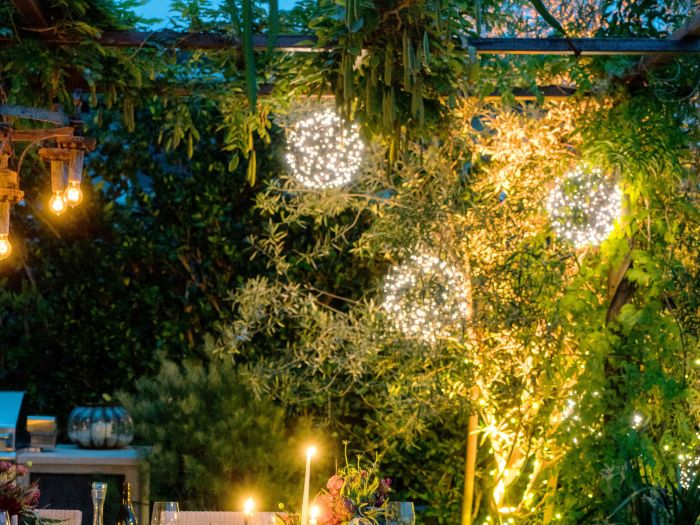 how to hang outdoor string lights three balls made of fairy lights hanging from large tree