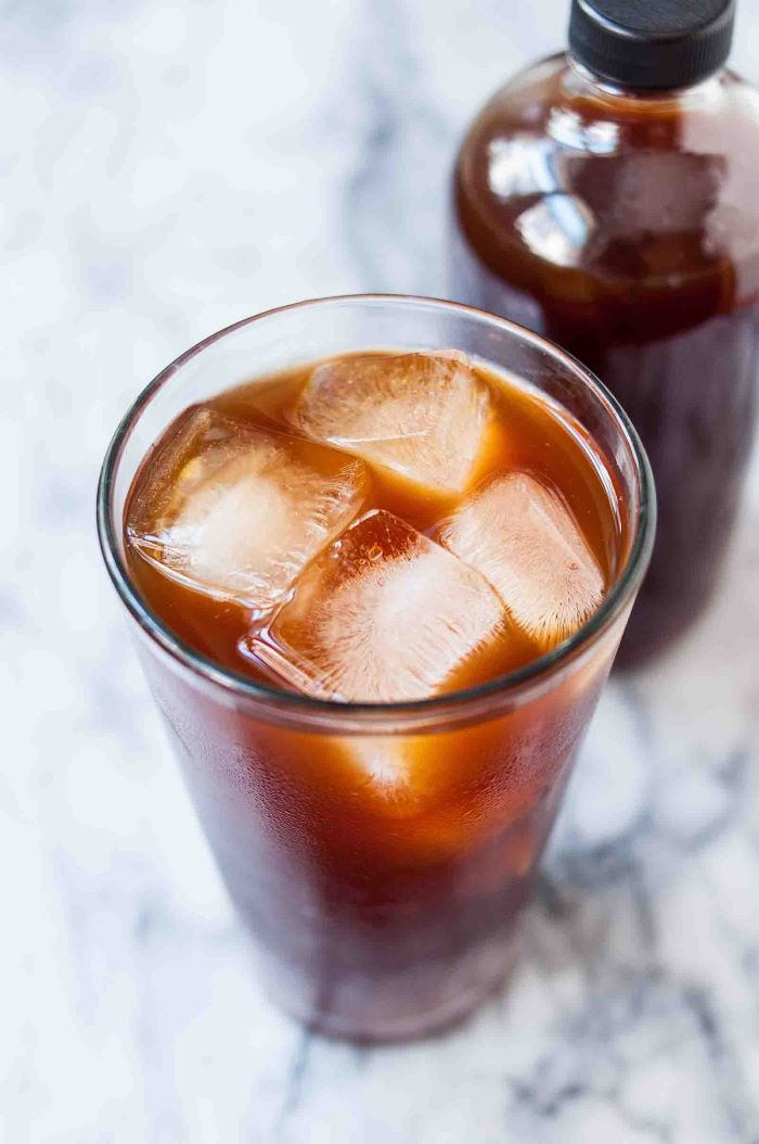 how to make coffee without a coffee maker glass filled with coffee and ice placed on marble surface