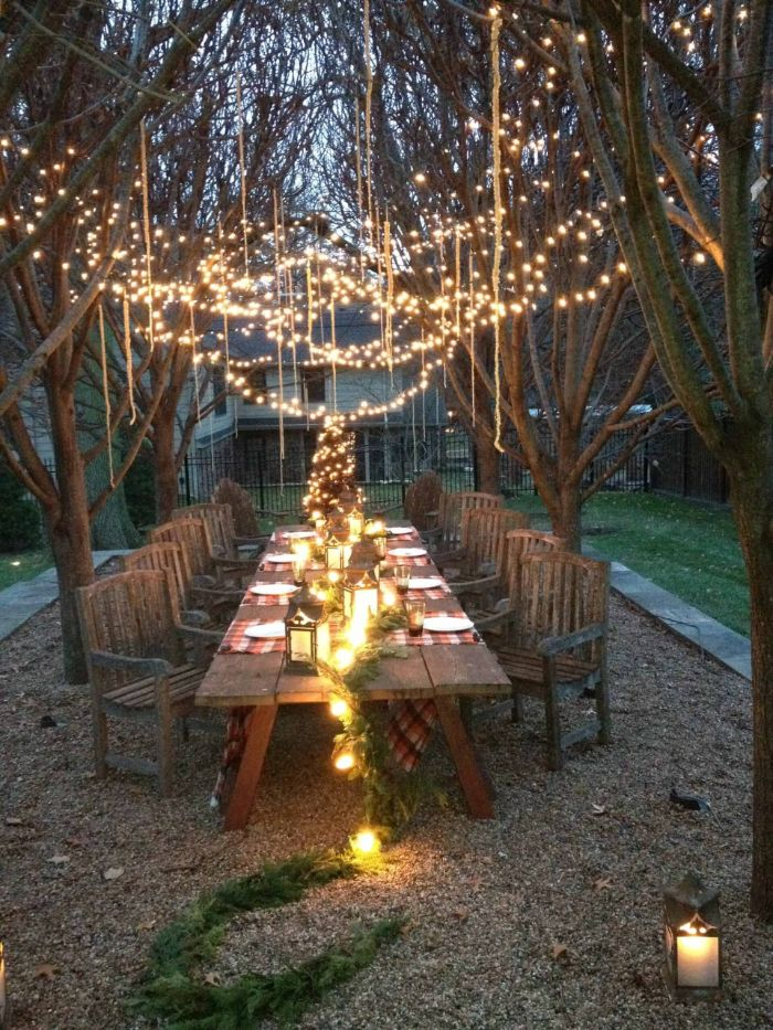 large dining table with chairs how to hang string lights on covered patio lots of string lights and fairy lights hanging from the trees