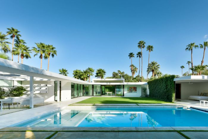 large pool in contemporary house with green garden backyard inground pools lots of palm trees