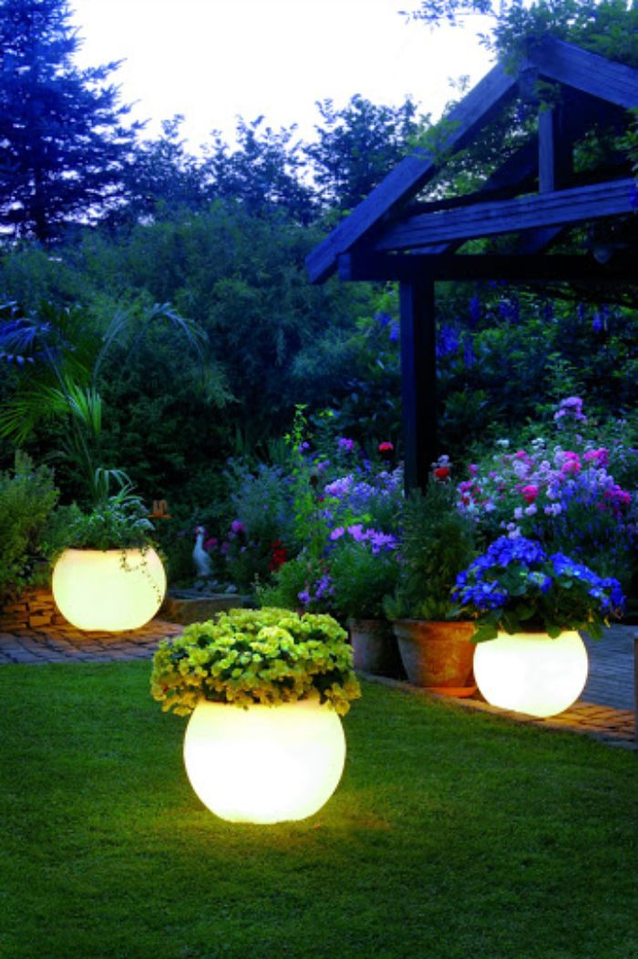 led planters scattered around a grass field next to gazebo how to hang string lights on covered patio flower beds
