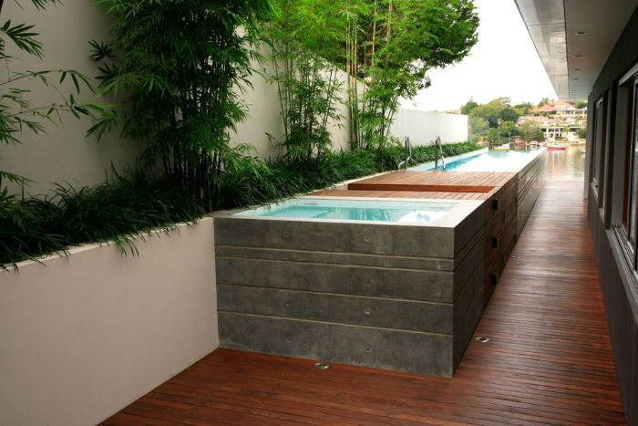 long above ground pool with small built in deck small inground pool cost surrounded by trees and bushes