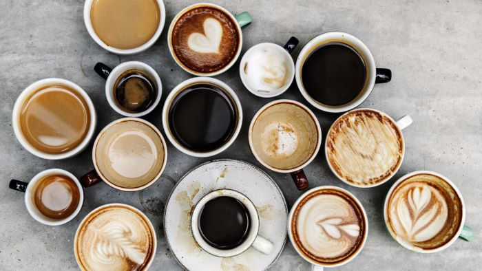 lots of coffee cups and mugs some with black coffee how to make coffee others with milk foam