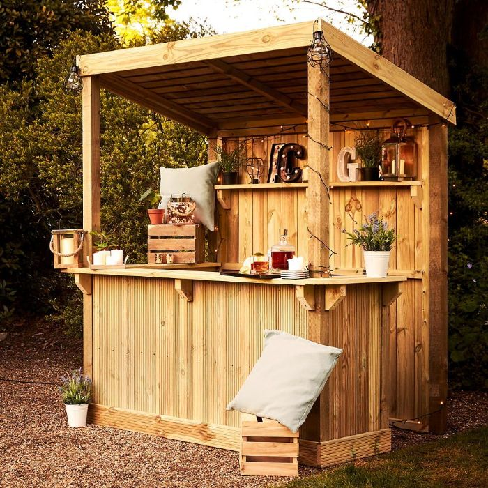 mini bar inside wooden enclosure how to build an outdoor bar decorated with lanterns crates throw pillows