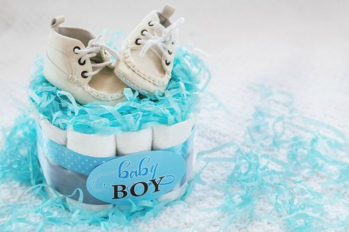 mini diaper cake decorated with blue and gray ribbon blue tissue paper baby shower ideas for girls two baby shoes on top