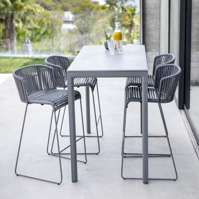 minimalistic bar with four black rattan bar stools outdoor kitchen bar small tall table