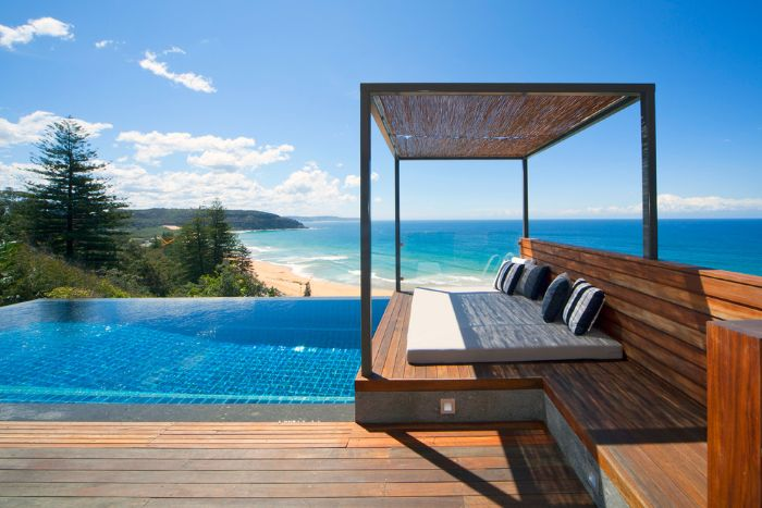 modern pool designs infinity pool with wooden deck and lounge area sea view