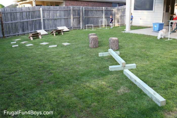 ninja warrior obstacle course build in the backyard with wooden logs and pallets outdoor fun for kids