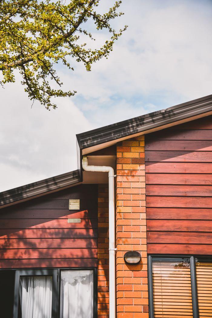 one storey house with wood siding brick decorations home siding black window frames