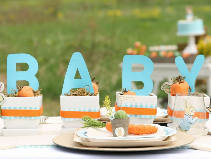 orange and blue ribbons over centerpieces spelling baby baby shower party favors peter rabbit theme