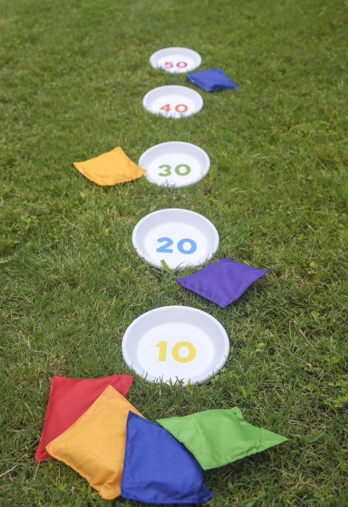 outdoor activities for kids white plates with different numbers in them for points corn bags thrown at them