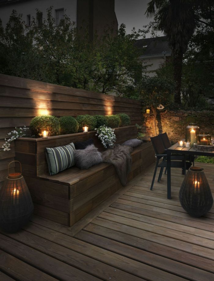 outdoor lighting ideas lanterns and candles placed on the floor and table lamps between the bushes