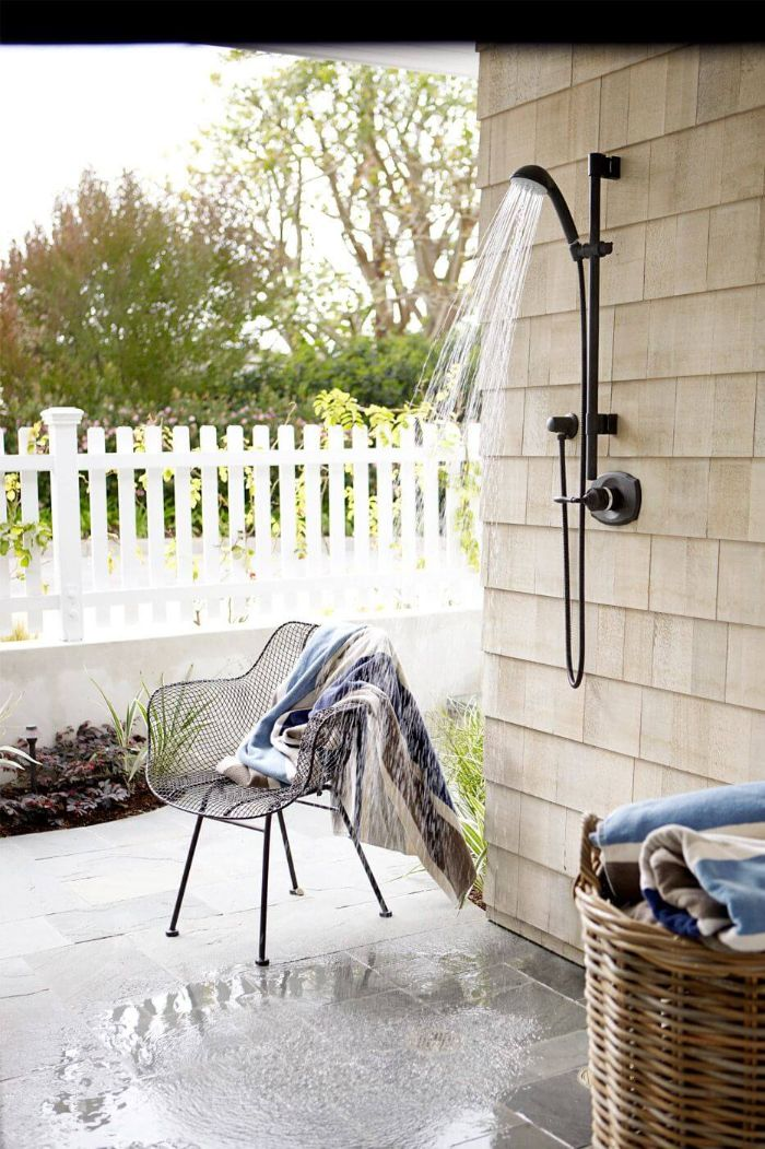 outdoor shower designs black shower mounted on tiled wall tiled floor metal chair next to it