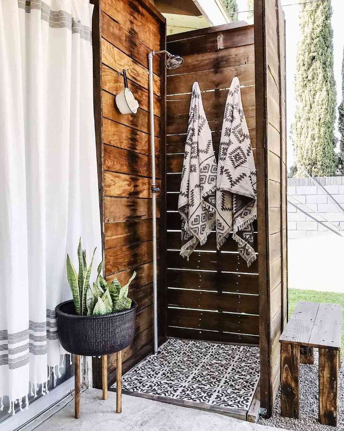 outdoor shower enclosure wood enclosure tall with hooks for towels metal shower black and white tiled floor