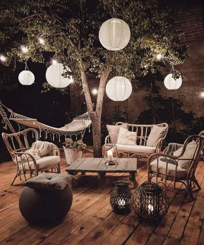 paper lanterns hanging from a tree how to hang outdoor string lights lounge area with garden furniture underneath