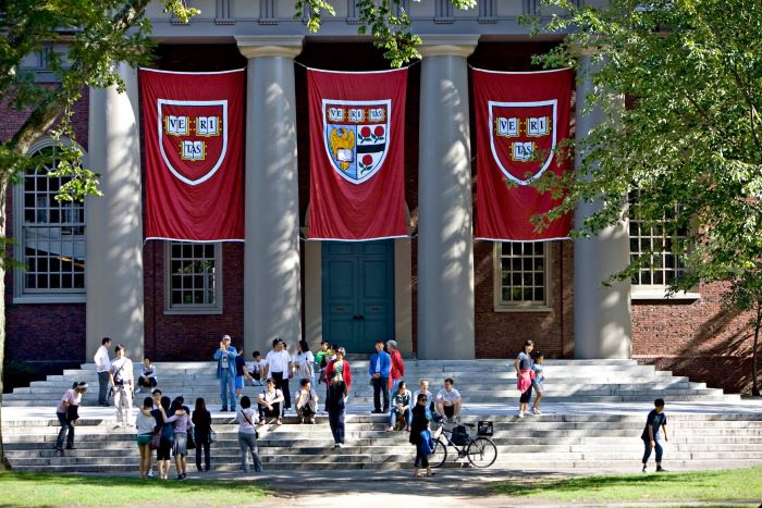 photo of the front entrance of harvard university best places to study architecture students standing outside