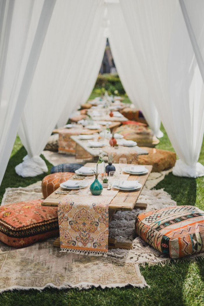picnic in the backyard baby shower party favors colorful cushions placed on carpets with small tables