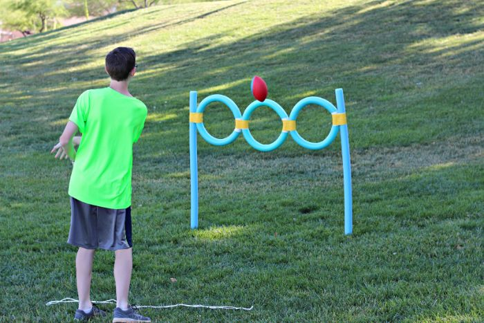 pool noodles turned into hoops games to play outside boy shooting a ball inside the hoops