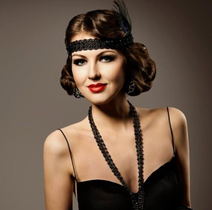 roaring 20s hairstyle on woman with brown hair most iconic looks wearing black dress