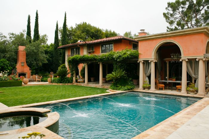 small inground pool cost spanish style home with pool with fountains ouside kitchen area
