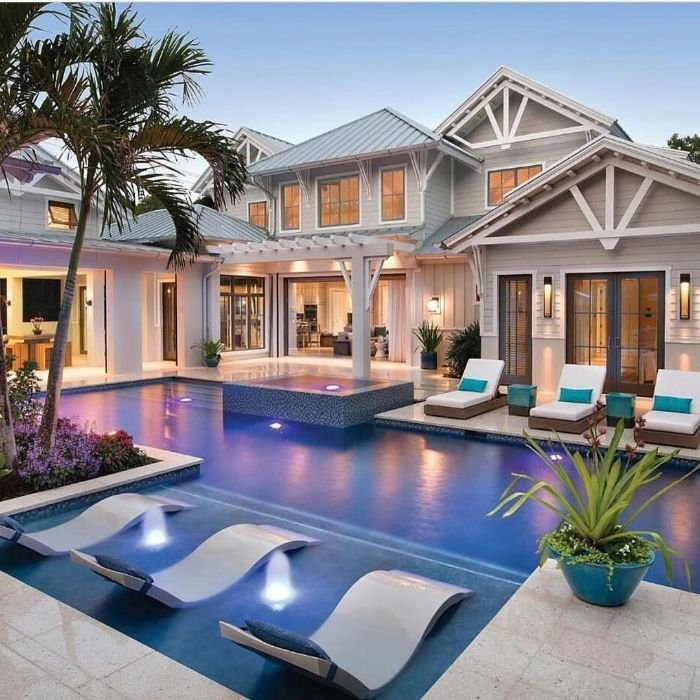 small inground pools two storey house with large pool in the backyard with small fountains with lounge chairs