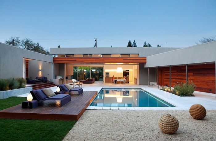small pool with led lamps pool landscaping ideas lounge chairs and table next to it with throw pillows