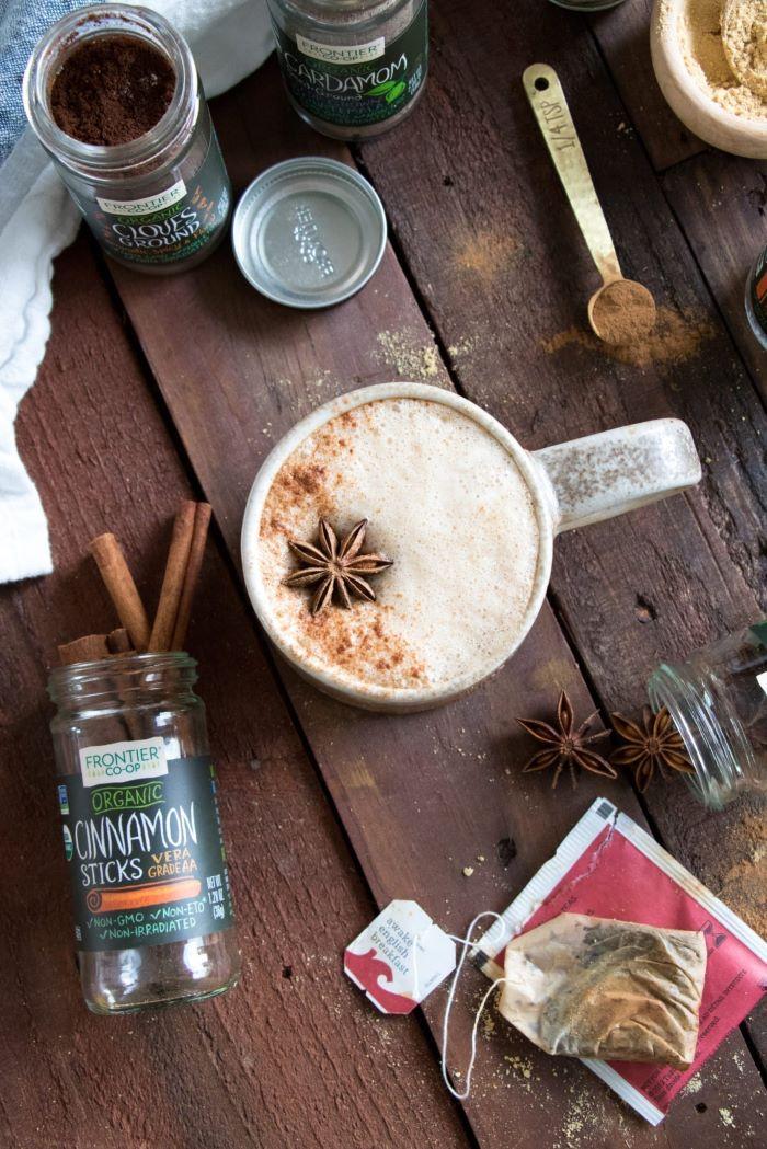 star anise on top of coffee poured into ceramic mug how to make good coffee vegan chai latte recipe