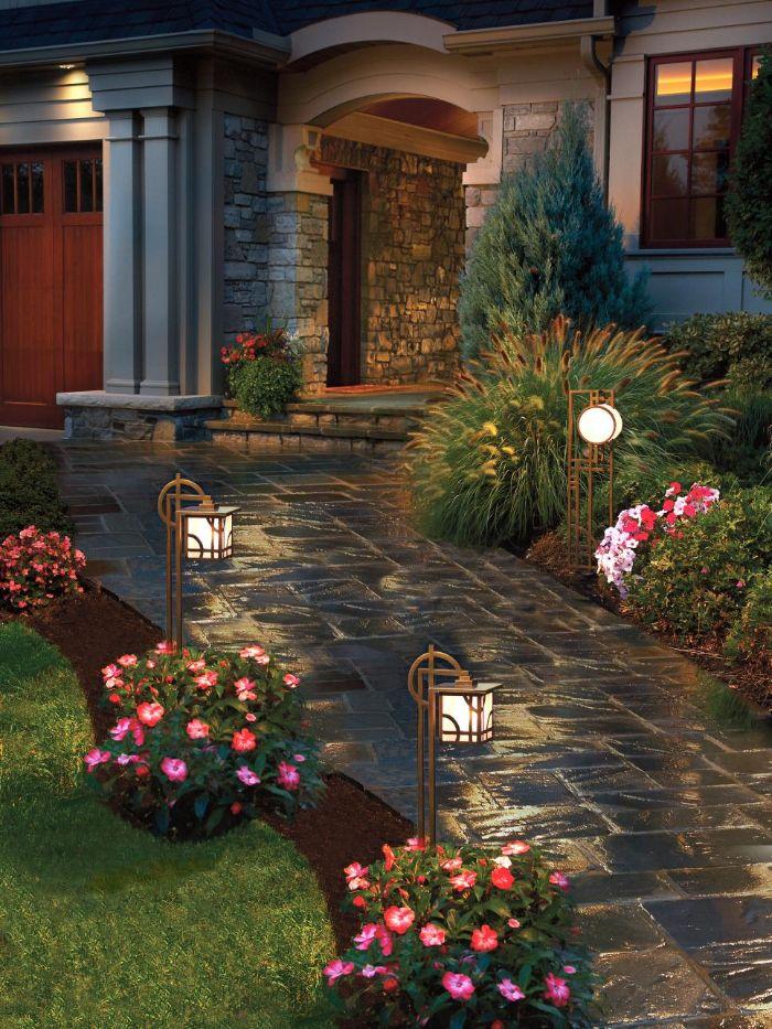 string light pole stone pathway leading to the door flower beds mini lanterns around it