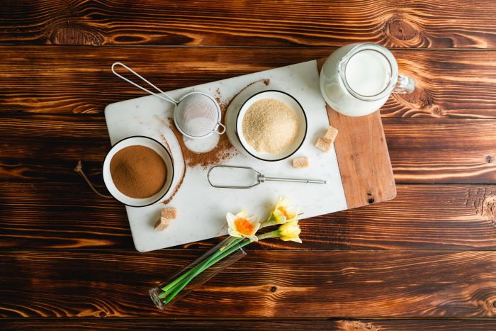 sugar milk coffee ingredients how to make coffee without a coffee maker placed on wooden chopping board