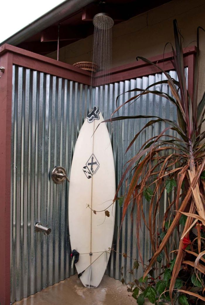 surf leaning on metal enclosure diy outdoor shower shower head above it