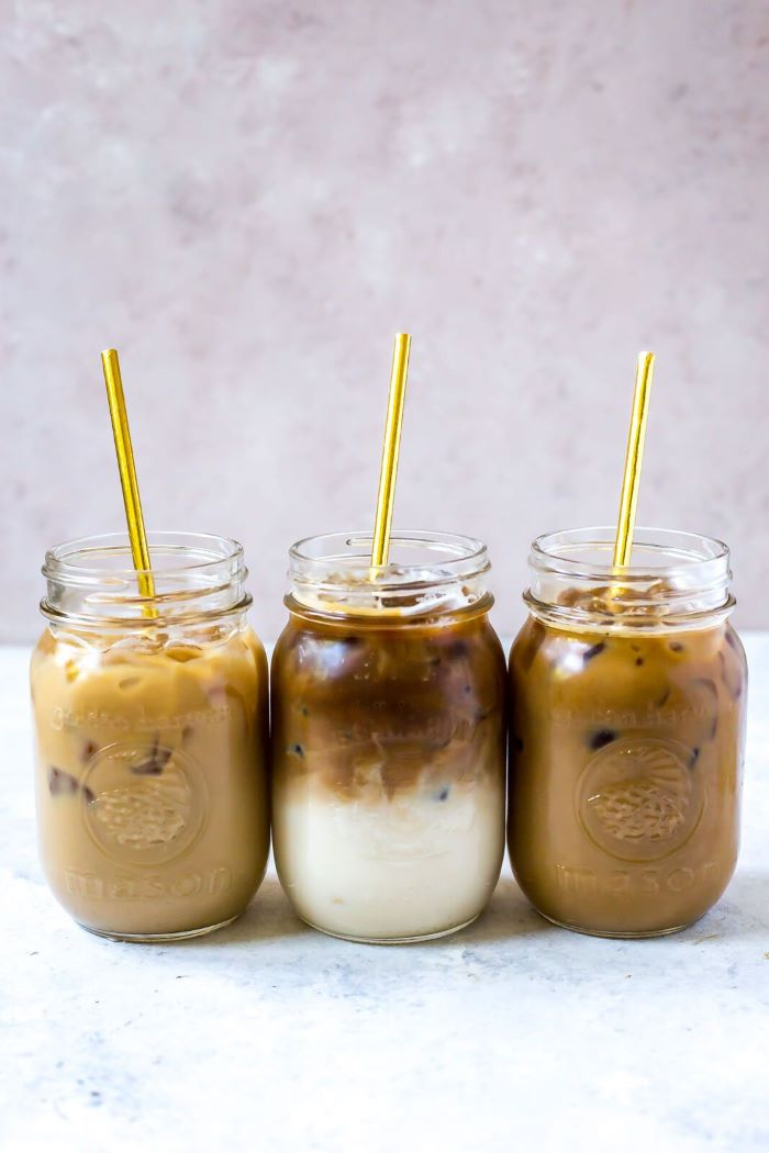 three mason jars filled with coffee and milk how to make cold brew coffee three metal gold straws