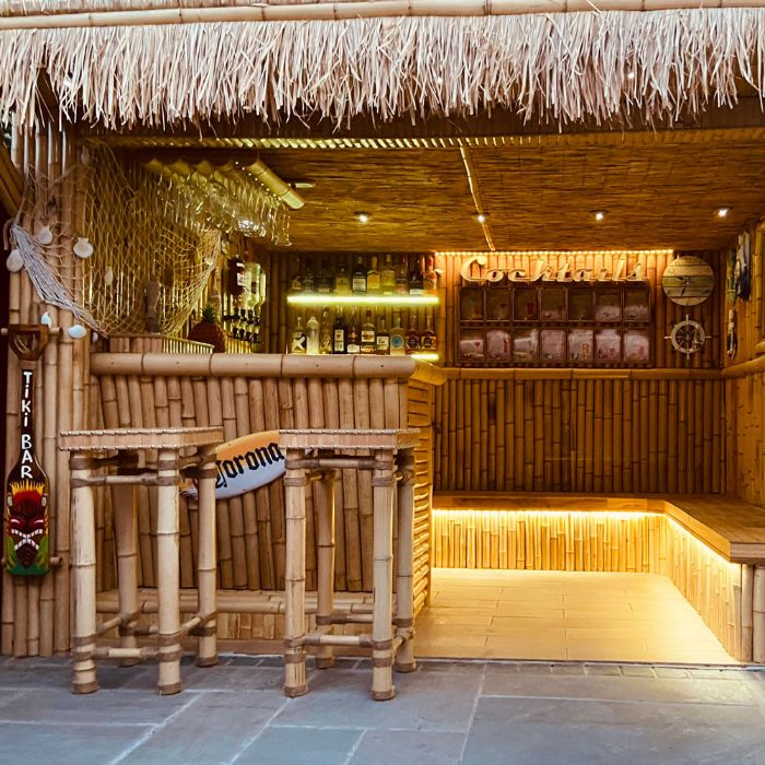 tiki bar made with bamboo and hay diy outdoor bar led benches shelves with different bottles