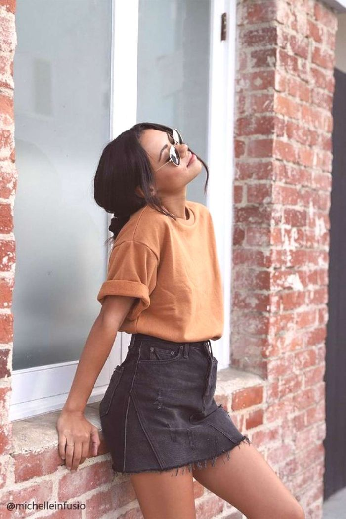 trendy clothes for teens black denim skirt orange t shirt sunglasses worn by girl with black hair