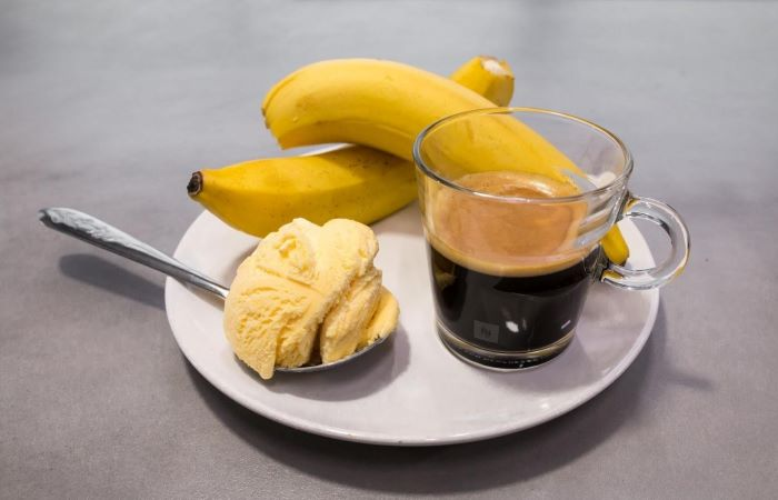 two bananas ice cream in a spoon coffee in mug how to make cold brew coffee placed on plate