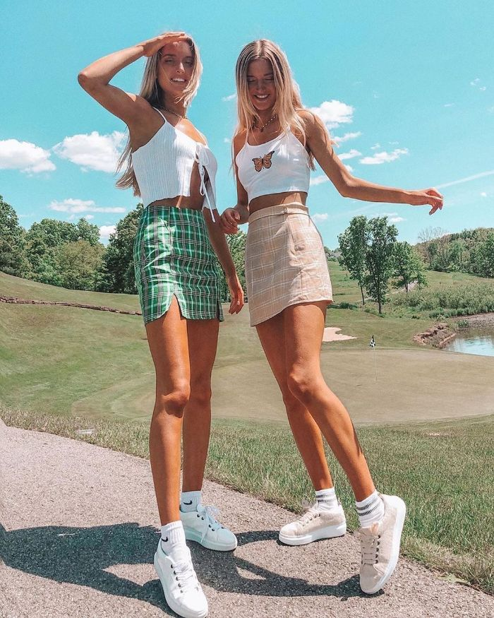 two blonde girls cute clothes for teenage girl wearing green and pink plaid skirts white crop tops white sneakers