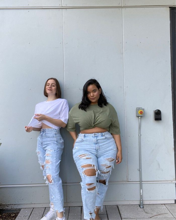 two girls posing cute outfits for teenage girl wearing ripped jeans t shirts sneakers
