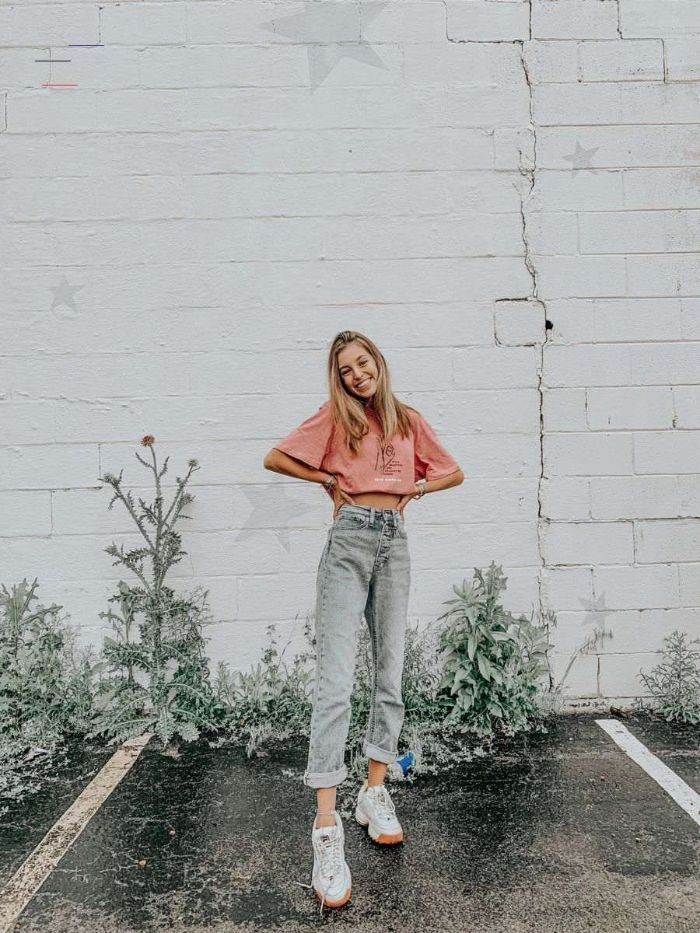 white brick wall cute outfits for teen girl wearing jeans white trainers pink t shirt