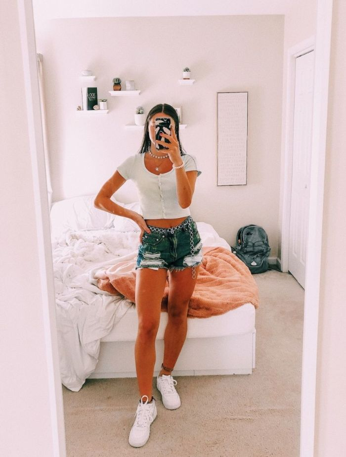 white crop top denim shorts white sneakers cute outfits for girls worn by girl with black hair