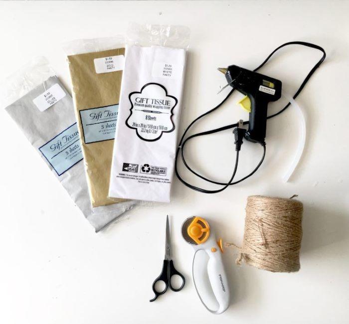 white gold silver gift tissue paper glue gun twine baby shower centerpiece ideas supplies for step by step diy tutorial for tassel garland