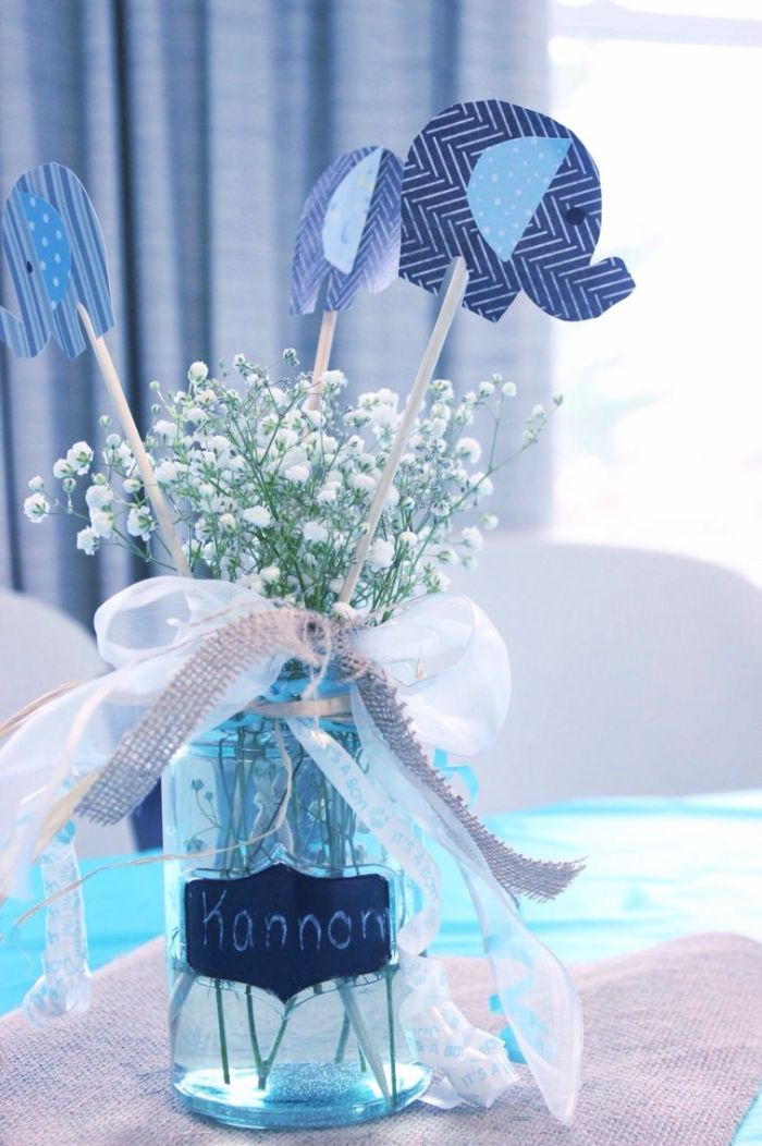 white ribbon and burlap wrapped around jar baby shower decorations girl filled with babys breath flowers