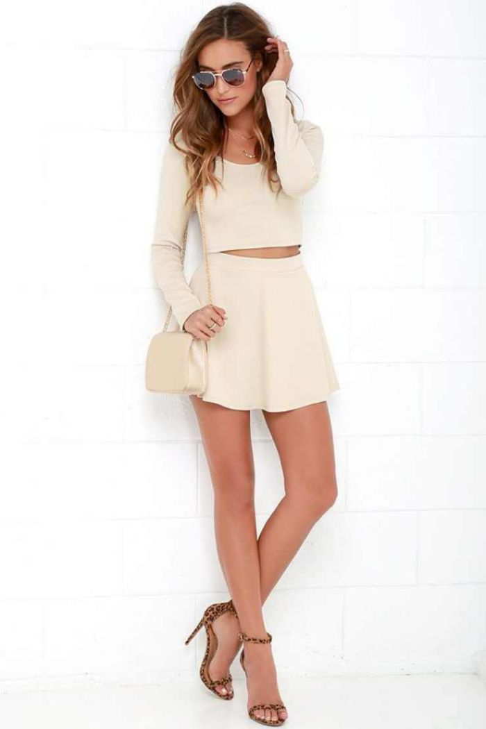 white skirt and cropped long sleeve blouse cute outfits for teenage girl worn by brunette woman