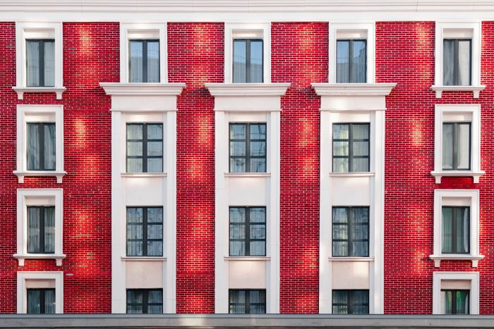 window installation apartment building with brick layout windows with black frames
